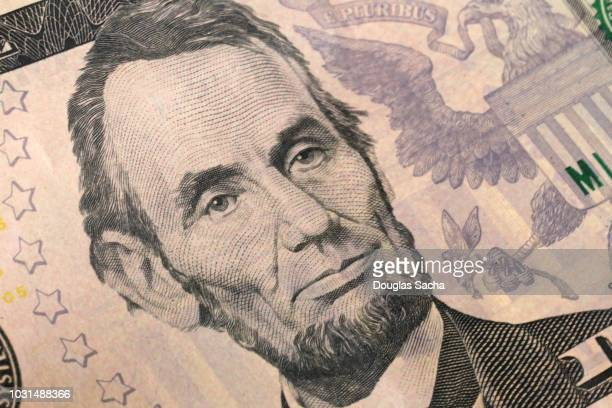 portrait of president abraham lincoln on us currency - money texture stock photos and pictures