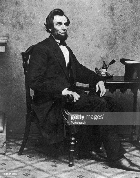 Portrait of President Abraham Lincoln sitting at a desk February 24 1861