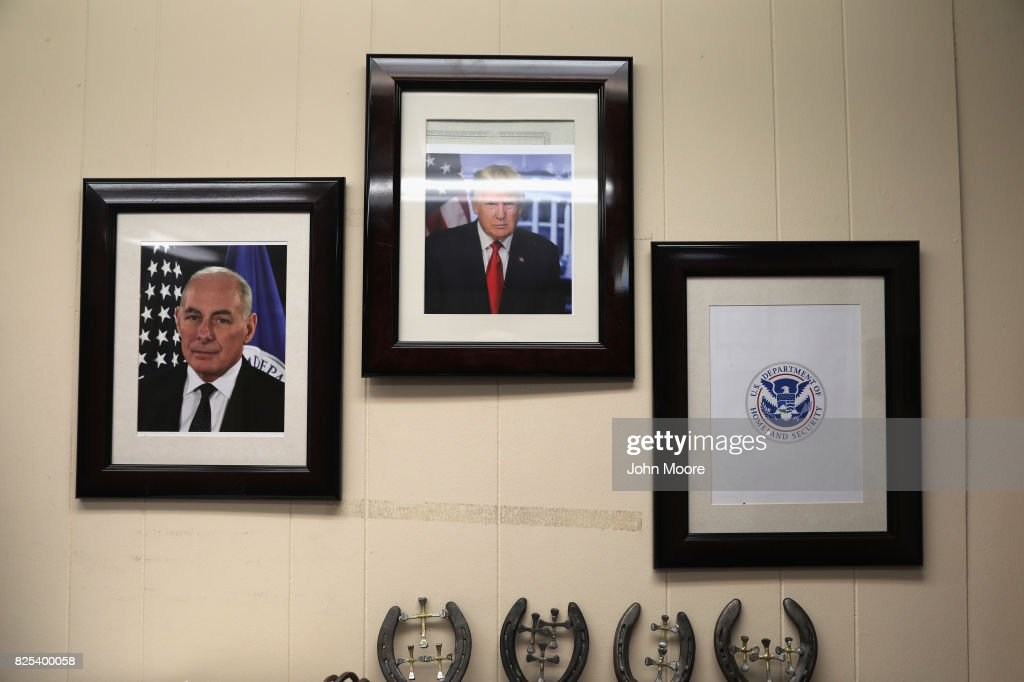 A portrait of President Donald Trump and his chief of staff John Kelly hang on the wall of a U.S. Air and Marine Operations (AMO), office on August 1, 2017 in El Paso, Texas. The AMO station, which performs helicopter patrols along the U.S.-Mexico border, is part of the Department of Homeland Security, formerly headed by General Kelly.