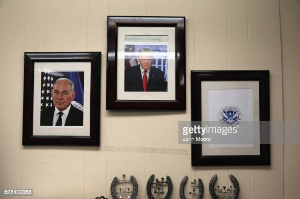 A portrait of President Donald Trump and his chief of staff John Kelly hang on the wall of a US Air and Marine Operations office on August 1 2017 in...