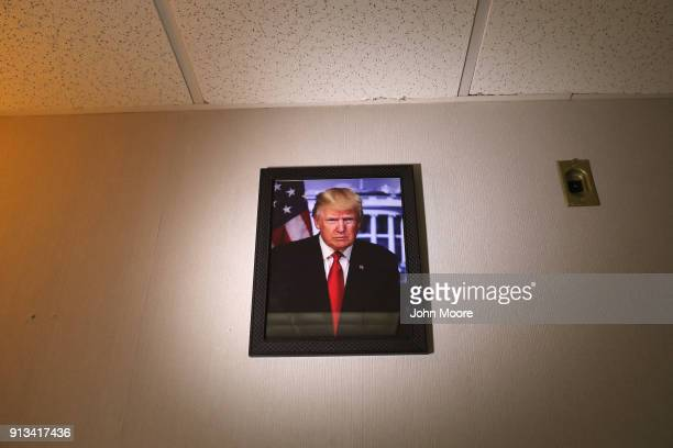 A portrait of President Donald Trump hangs on the wall during a naturalization ceremony on February 2 2018 in New York City US Citizenship and...