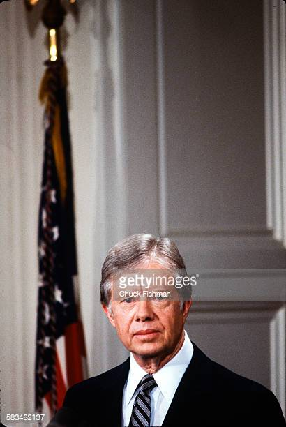 Portrait of President Jimmy Carter standing at a podium during a White House press conference Washington DC March 1980