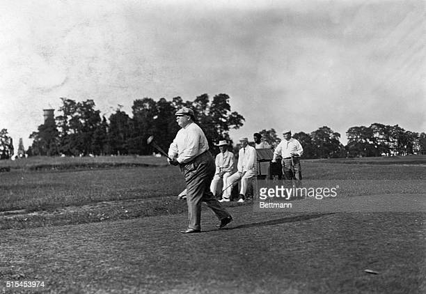 Portrait of President William Howard Taft keeping score on the golf course Undated photograph