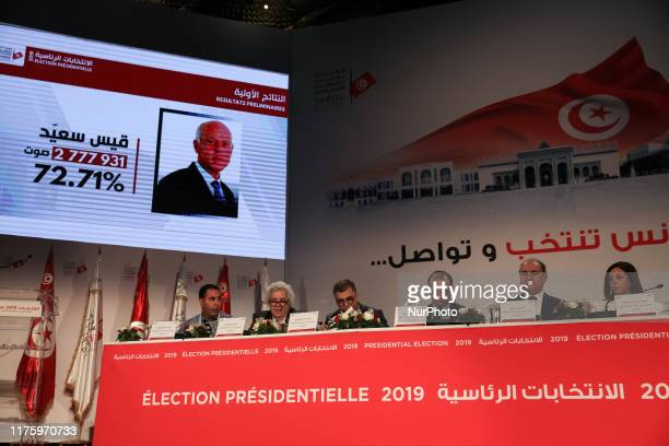 Portrait of presidential candidate Kais Saied screened during a press conference held by the Independent High Authority for Elections , to announce...