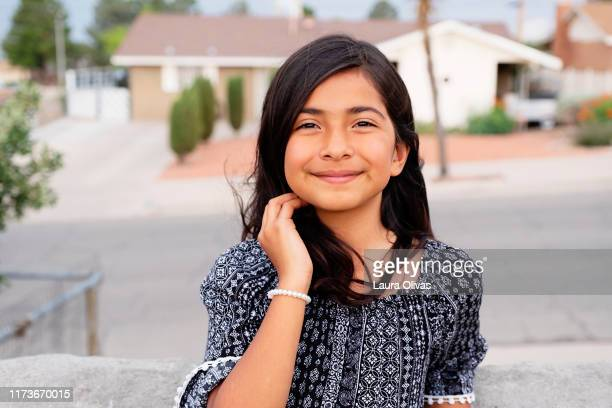 portrait of pre-teen girl in her neighborhood - pre adolescent child stock pictures, royalty-free photos & images