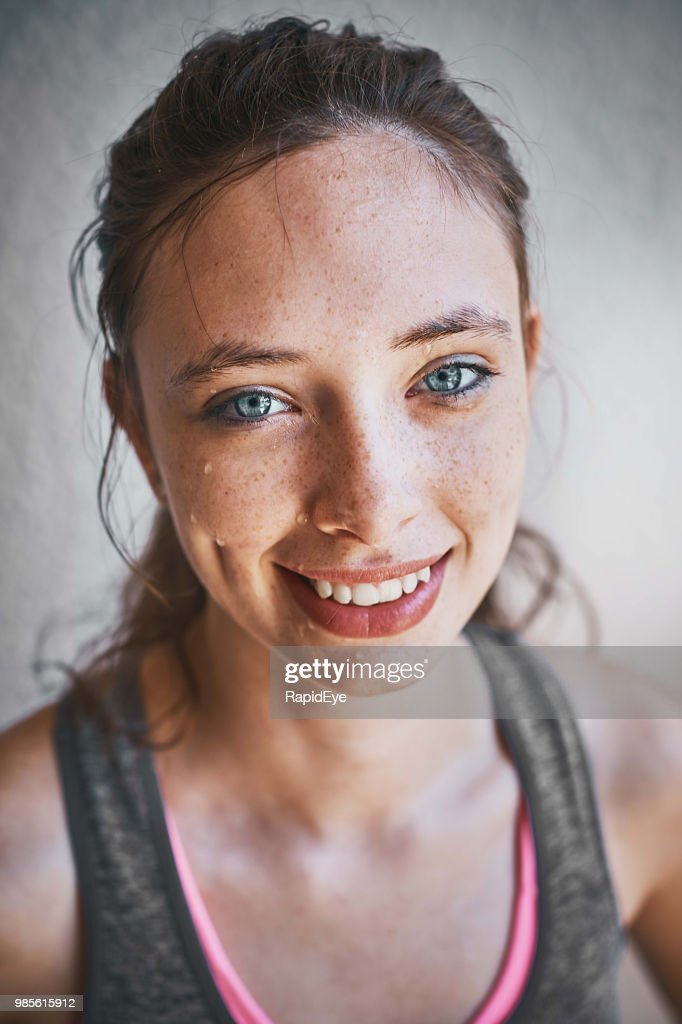 Portrait of pretty, athletic young woman smiling : Stock Photo
