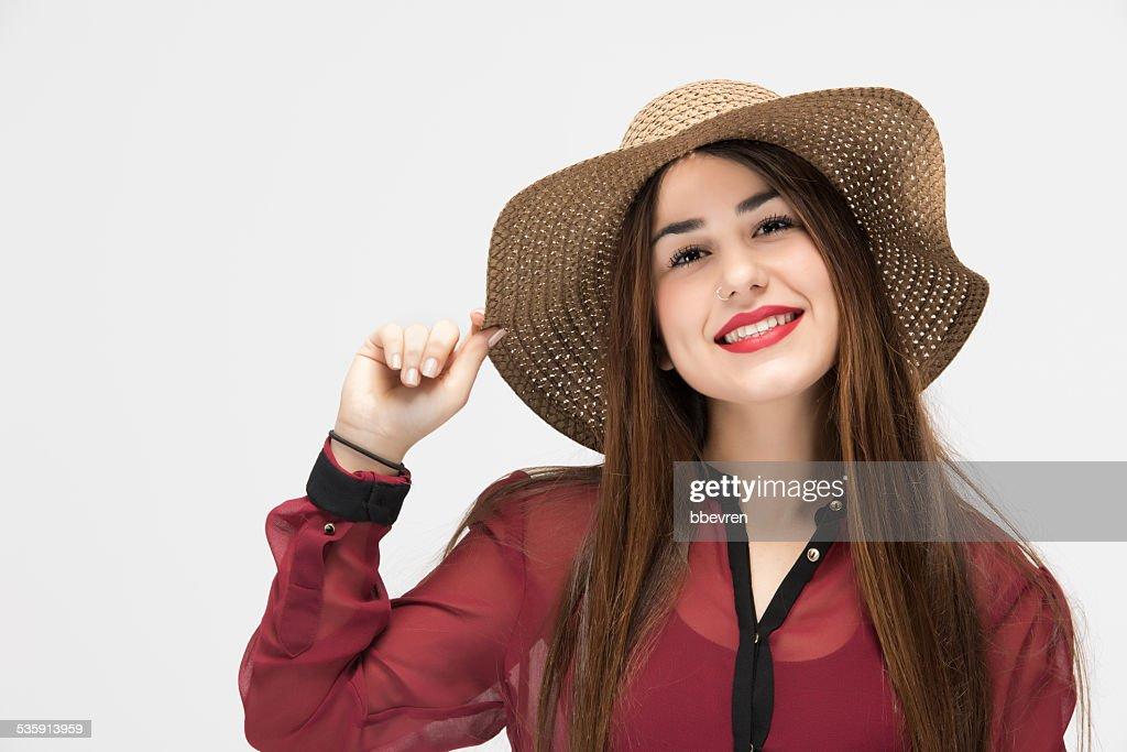 Portrait of pretty latino girl with straw hat : Stock Photo