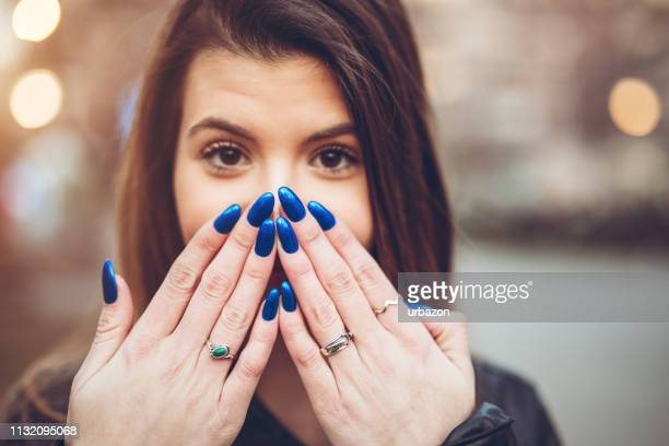 portrait of pretty young woman - fingernail stock pictures, royalty-free photos & images