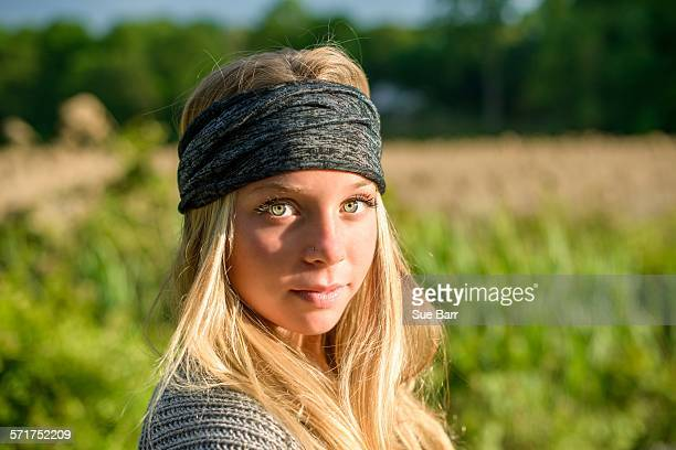 portrait of pretty young woman with green eyes wearing bandana - green eyes stock pictures, royalty-free photos & images