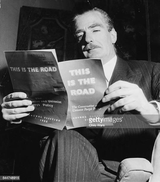 Portrait of Prime Minister Sir Anthony Eden reading his party's book 'This is the Road' 1950