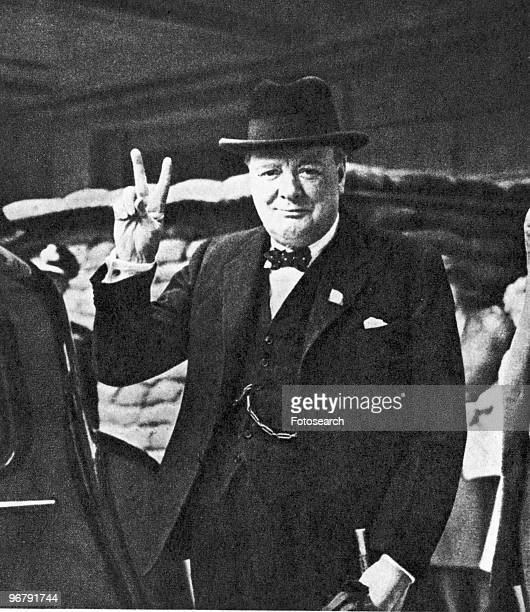 Portrait of Prime Minister Winston Churchill showing his victory sign circa 1941