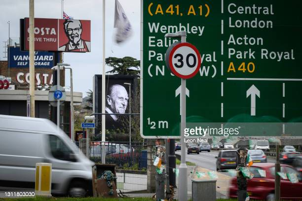Portrait of Prince Philip Duke Of Edinburgh who died at age 99, is seen on a digital billboard among the roadsigns and adverts, on April 10, 2021 in...