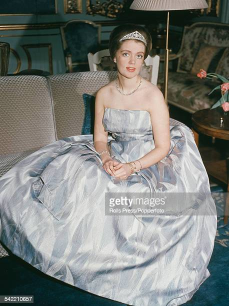 Portrait of Princess Birgitta of Sweden pictured wearing a tiara and ballgown whilst sitting on a couch circa 1960
