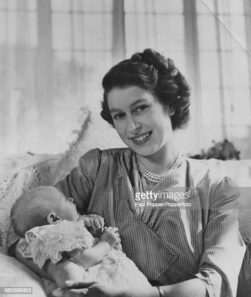 Portrait of Princess Elizabeth and her baby daughter Princess Anne, pictured together on the eve of her christening at Buckingham Palace, London,...