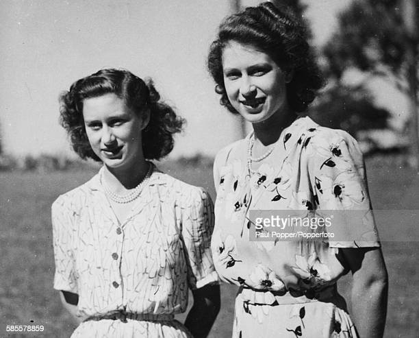 Portrait of Princess Elizabeth and her sister Princess Margaret pictured standing together in the grounds of Government House in Bloemfontein during...