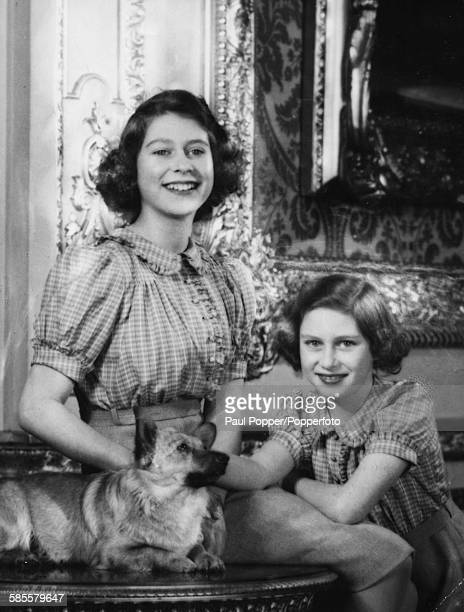 Portrait of Princess Elizabeth and Princess Margaret pictured together with a pet corgi 1941