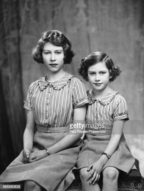 Portrait of Princess Elizabeth and Princess Margaret posed together in December 1938