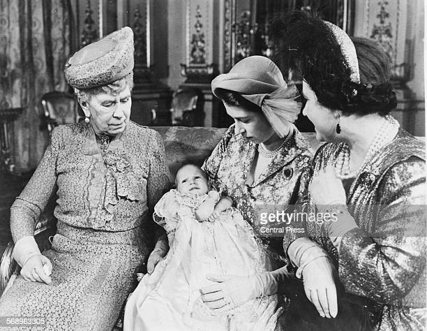 Portrait of Princess Elizabeth holding her baby daughter Princess Anne with the grandmothers Queen Mary and Queen Elizabeth following the christening...