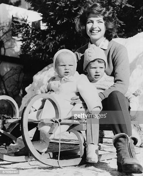 Portrait of Princess Ira von Furstenberg of Austria with her sons Christof and Ubertus outside their cottage 'Bella' in Cortina d'Ampezzo March 10th...