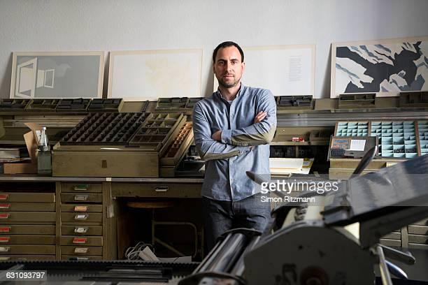 Portrait of printer in his workshop