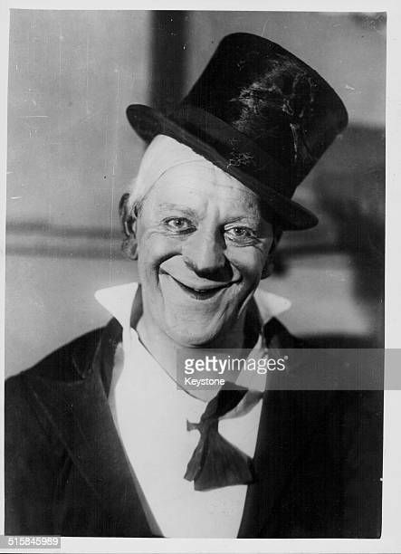 Portrait of professional clown Grock born Charles Adrien Wettach wearing a top hat and loose bow tie circa 1920