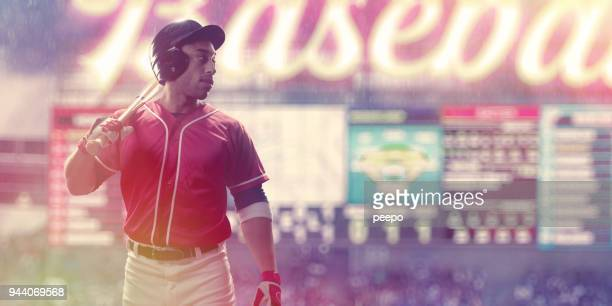 portrait of professional male baseball player in front of scoreboard - scoreboard stock pictures, royalty-free photos & images