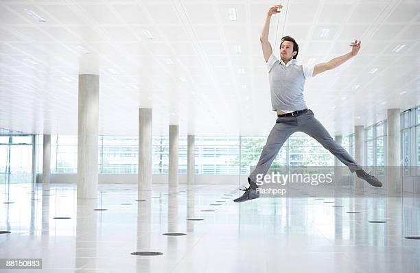 Portrait of professional man leaping