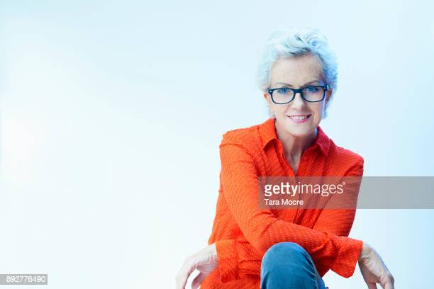 portrait of professional mature woman - women in transparent clothing stock photos and pictures