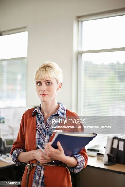 """portrait of professional woman in an office - """"compassionate eye"""" stock pictures, royalty-free photos & images"""