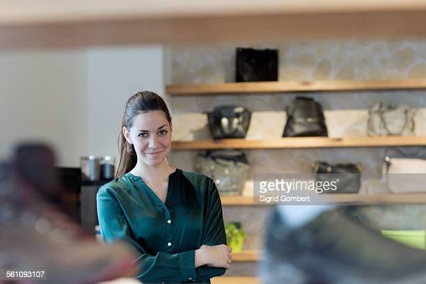 portrait of proud female sales assistant in shoe shop - sigrid gombert - fotografias e filmes do acervo