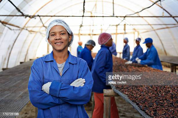 Portrait of proud worker at fruit farm