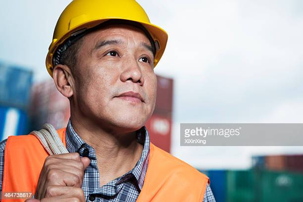 portrait of proud worker in protective workwear in a shipping yard - dock worker stock photos and pictures