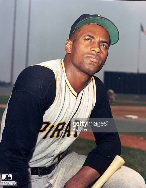 Portrait of Puerto Ricanborn baseball player Roberto Clemente in his Pittsburgh Pirates uniform and holding a baseball bat 1960s