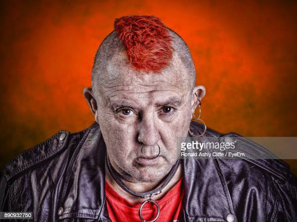 Portrait Of Punk Against Red Wall
