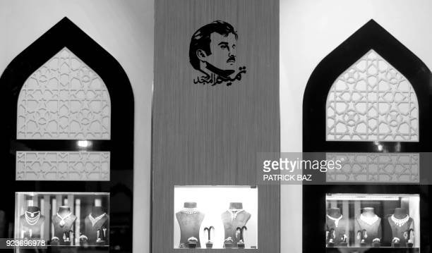 A portrait of Qatar's Emir Sheikh Tamim bin Hamad Al Thani is seen during the Doha Jewellery and watches exhibitions in the Qatari capital on...