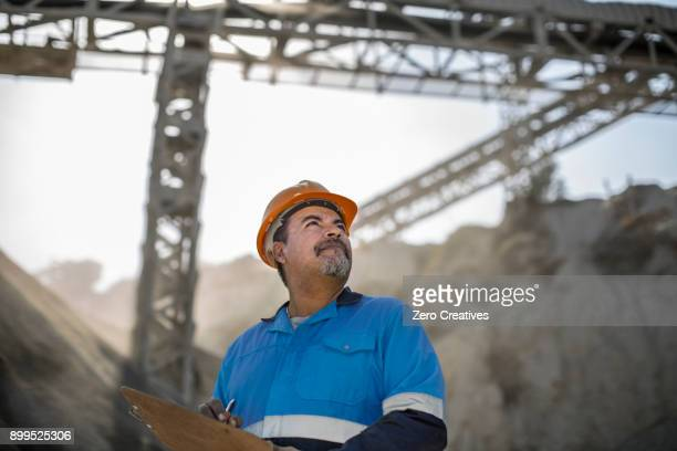 portrait of quarry worker in quarry - foreman stock pictures, royalty-free photos & images