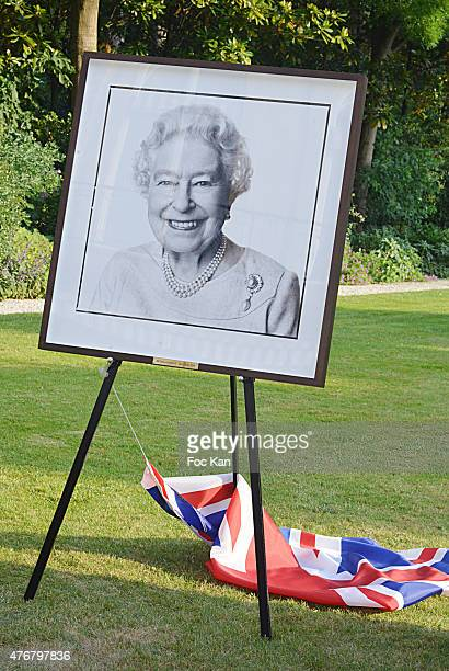 A portrait of Queen Elizabeth II by photographer David Bailey is exhibited during the British 'Summer Time 2015' Cocktail At the British Embassy And...