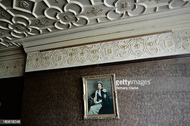 A portrait of Queen Elizabeth II hangs in a dining room in Pineheath house on September 4 2013 in Harrogate England The untouched 40bedroom house...
