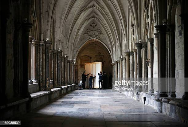 A portrait of Queen Elizabeth II is carried through the cloisters at Westminster Abbey on May 17 2013 in London England An official portrait of Her...