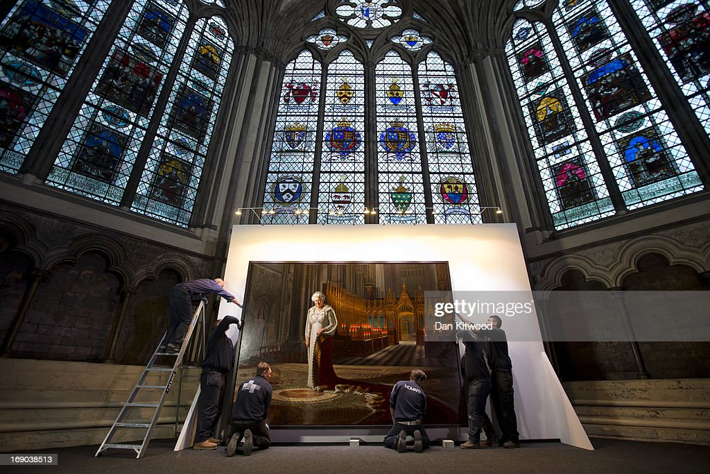 A portrait of Queen Elizabeth II is moved to it's final position in the Chapter House at Westminster Abbey on May 17, 2013 in London, England. An official portrait of Her Majesty The Queen has been installed at Westminster Abbey by MOMART Ltd, fine art handlers. The painting, entitled 'Coronation Theatre: Portrait Of Her Majesty Queen Elizabeth II' by artist Ralph Heimans goes on public display for the first time in London in the Chapter House of Westminster Abbey, and will be open to the public from Thursday 23rd May until Friday 27th September.