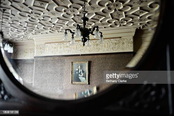 A portrait of Queen Elizabeth II is reflected in a dresser in a dining room in Pineheath house on September 4 2013 in Harrogate England The untouched...