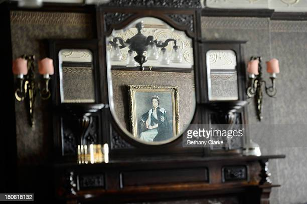 A portrait of Queen Elizabeth II is reflected in a dresser in Pineheath house on September 4 2013 in Harrogate England The untouched 40bedroom house...
