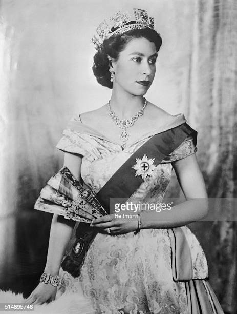 Portrait of Queen Elizabeth II of England wearing tiara and ribbon of the order of the Garder.