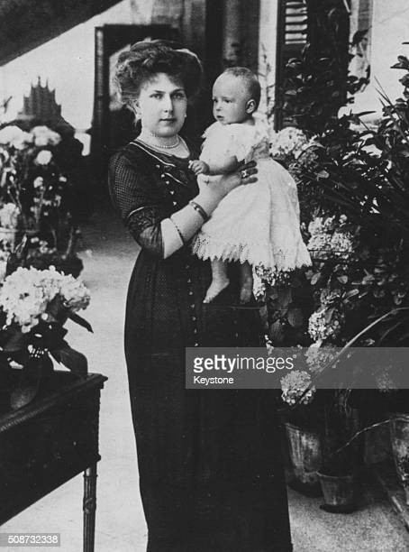 Portrait of Queen Victoria Eugenie of Spain holding her baby daughter Princess Beatriz 1909