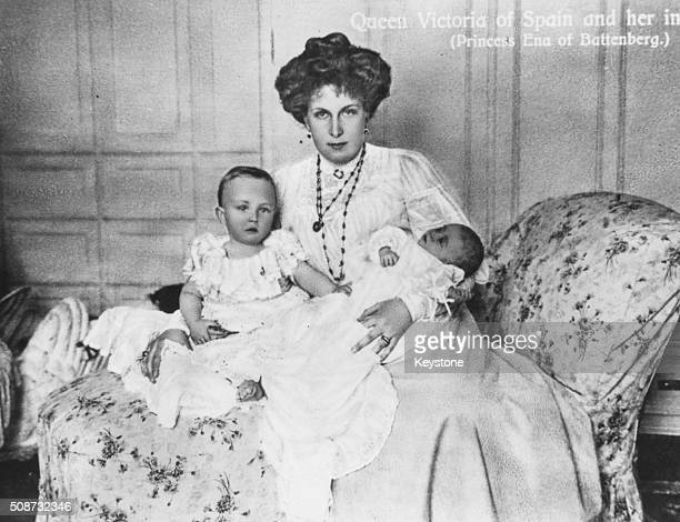Portrait of Queen Victoria Eugenie of Spain holding her children Prince Alfonso and Prince Jamie 1908