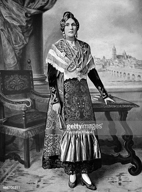 Portrait of Queen Victoria Eugenie of Spain wearing the traditional costume circa 1930 in Spain