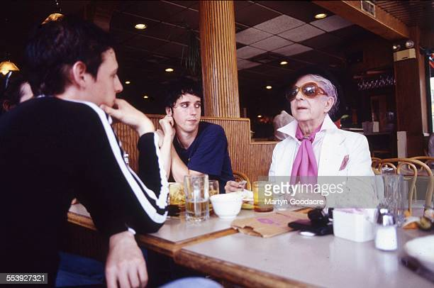 Portrait of Quentin Crisp in a New York diner with Steve Hussey and Julian Hewings of British rock band These Animal Men , United States, 1995.