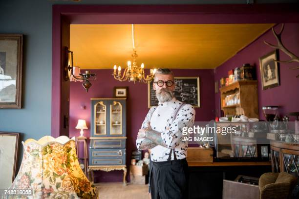 portrait of quirky vintage senior man in tea rooms - suspenders stock pictures, royalty-free photos & images