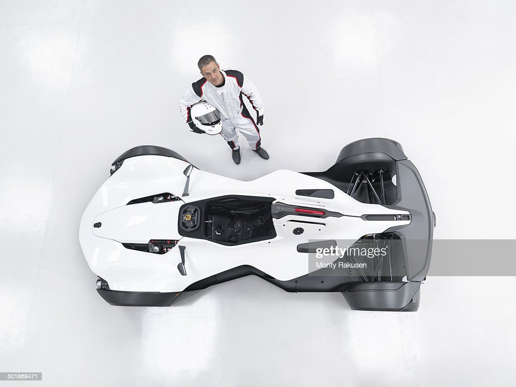 Portrait of racing driver next to supercar, overhead view : Stock Photo
