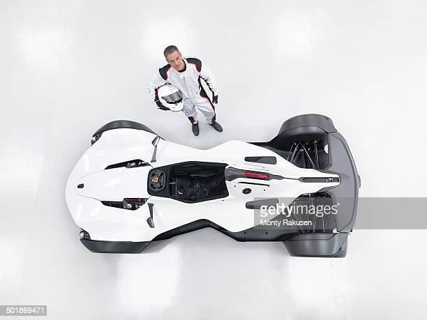 portrait of racing driver next to supercar, overhead view - will power race car driver stock pictures, royalty-free photos & images